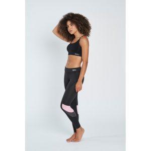 malla lycra negro con detalles en rosa en la rodilla por delante y por detras. Deportivo