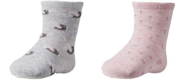 calcetín bebé pack de 2 unidades sobre tonos rosas