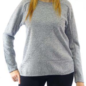 Jersey de punto para mujer tejido grueso de espiga. Abertura en laterales