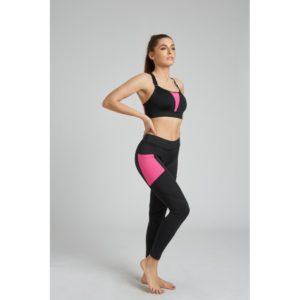 malla deportiva mujer negra con detalles semi transparentes y bolsillos laterales de color fuxia